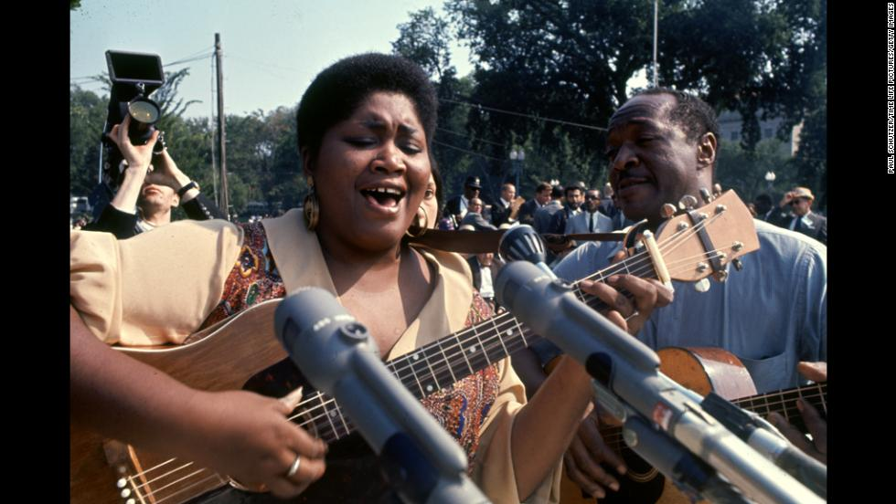 Musician Odetta Holmes plays a song during the march.