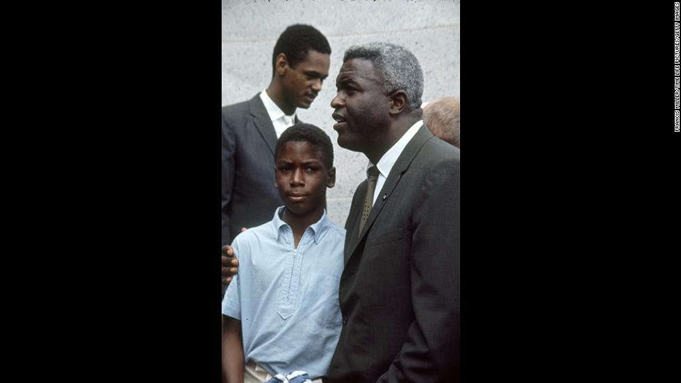 Baseball player Jackie Robinson, right, attends the rally with his son David.