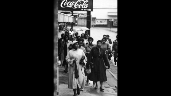 African American women walk along the sidewalk during a bus boycott, Montgomery, Alabama, February 1956.