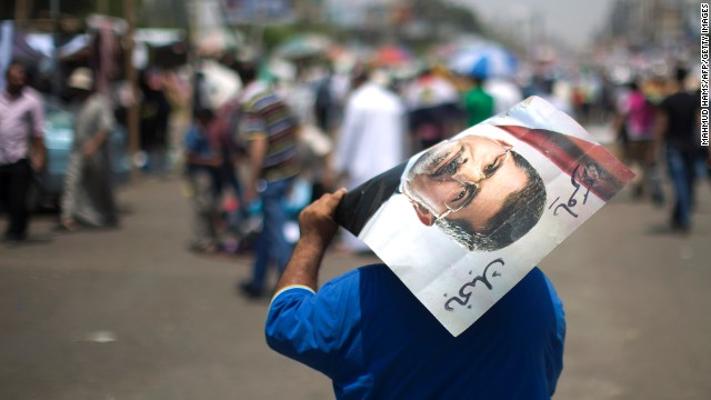 A supporter of the Muslim Brotherhood holds a poster of deposed president Mohamed Morsy in July.