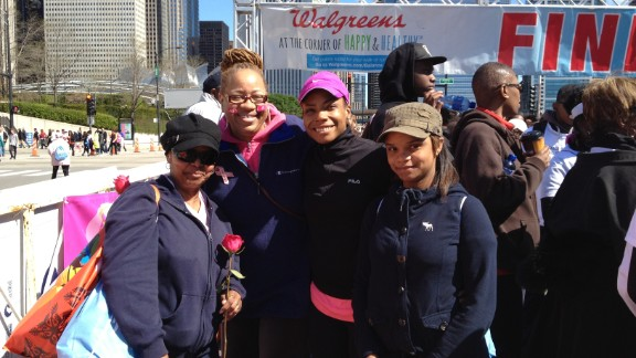 """""""I have a love/hate relationship with running, """" says Horton, here in a pink hat. She began walking the trail in her neighborhood, and then one day she decided to run. She's been running ever since."""