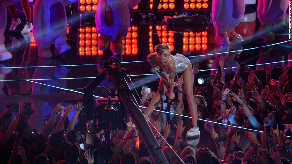 "Miley Cyrus stunned the crowd at the Barclays Center in Brooklyn, New York, at the 2013 MTV Video Music Awards on Sunday, August 25. Cyrus' ""We Can't Stop"" performance featured her now-signature twerking and a crotch grab or two. After she donned the fuzzy gray leotard pictured here ..."