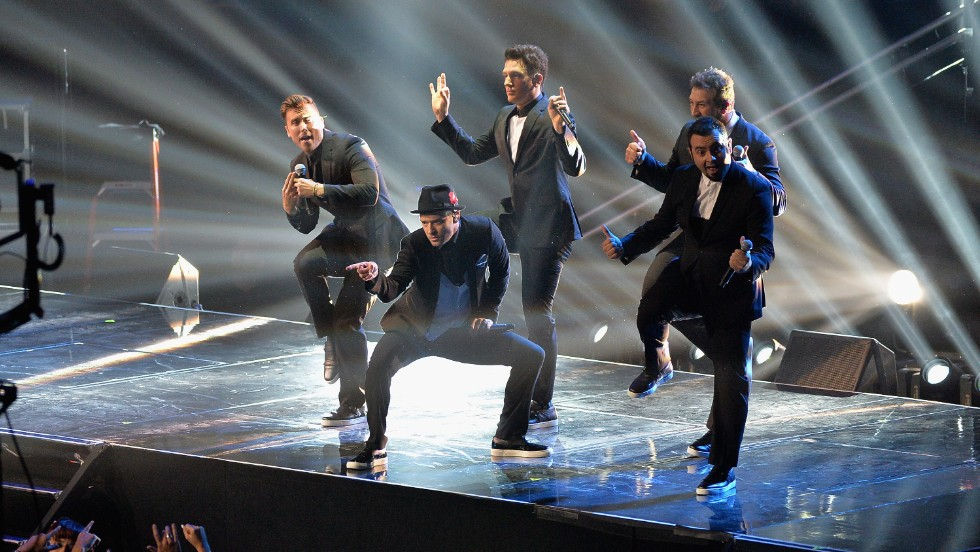 "... 'N Sync ""<a href=""http://www.cnn.com/2013/08/21/showbiz/celebrity-news-gossip/lance-bass-nsync-reunion/?hpt=en_c1"">surprised</a>"" the crowd when the group reunited on stage. It was only a brief interlude during JT's performance, but it was awesome to see (from left) Lance Bass, JC Chasez, Joey Fatone and Chris Kirkpatrick making beautiful music together again."