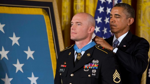 President Barack Obama awards U.S. Army Staff Sgt. Ty M. Carter the Medal of Honor on Monday, August 26. Carter received the medal for his courageous actions as a cavalry scout during combat operations in the Kamdesh District of Afghanistan's Nuristan Province on October 3, 2009. He is the fifth living recipient to be awarded the Medal of Honor for actions in Iraq or Afghanistan.