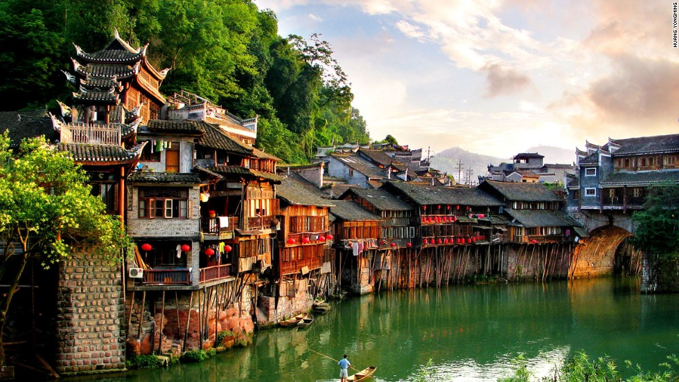 "Every year, armies of young backpackers flock to the ancient town of Fenghuang (which literally means ""Phoenix"") in Hunan province, for its rich Miao and Tujia ethnic culture as well as a glorious photo opportunity."