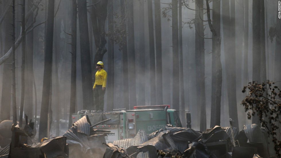 A firefighter stands on top of a fire truck at a campground destroyed by the Rim Fire near Yosemite National Park on August 26. The massive wildfire grew during the week and became the 5th largest in state history, state fire authorities said.