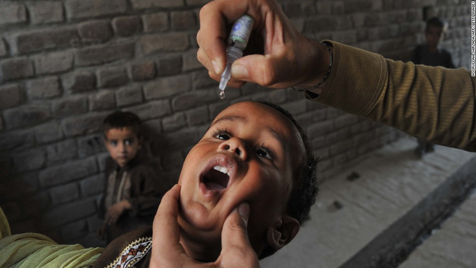 "AUGUST 27 - JALALABAD, AFGHANISTAN: A health worker administers polio vaccine drops to an Afghan child. <a href=""http://cnn.com/2012/07/27/health/polio-eradication-efforts"">Polio</a>, once a worldwide scourge, is endemic in just three countries now -- Nigeria, Afghanistan and Pakistan. But the global goal to <a href=""http://cnn.com/2012/10/02/health/time-un-polio"">eradicate polio by 2015</a> is threatened by frequent <a href=""http://cnn.com/2013/05/28/world/asia/pakistan-polio-workers-attack"">attacks on the health workers</a> giving the vaccination."