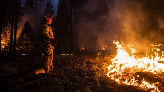 Sacramento Metropolitan firefighter John Graf monitors the Rim Fire line near Camp Mather, California, on Monday, August 26.