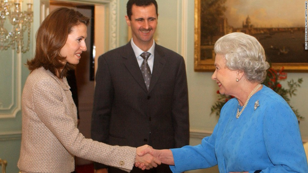 The first couple meets with Queen Elizabeth at Buckingham Palace in London, on December 17, 2002.