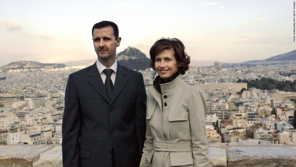 Bashar al-Assad and Asma al-Assad pose for photographers during their visit to Acropolis archaeological site in Athens, Greece, on December 15, 2003.
