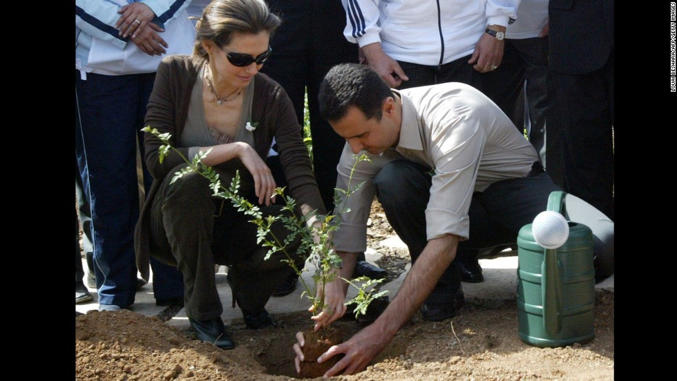The Syrian first couple plant a jasmine bush in old Damascus on April 27, 2007.