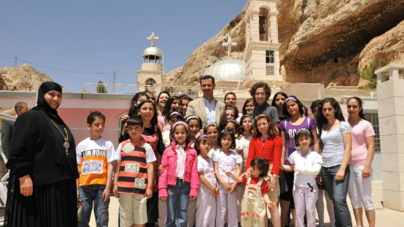 The Syrian first couple celebrate Orthodox Easter with orphans at the Mar Taqla convent in the village of Ma'loula, Syria, on April 27, 2008.