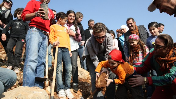 Al-Assad plants trees with children during a tree planting campaign in Yafour, Syria, on December 5, 2009. Over 3,000 trees, including pine, cypress, linden and wild pear, were planted.