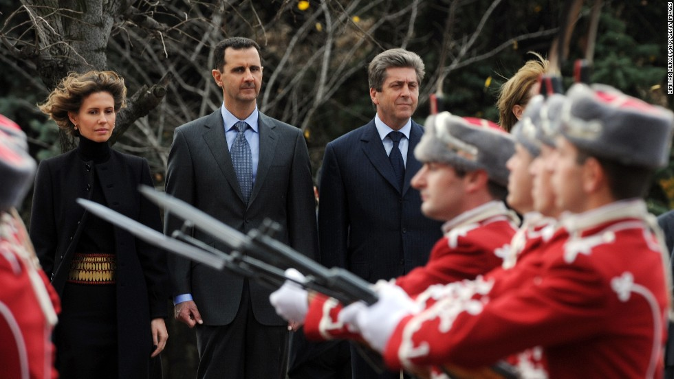 Syrian's first couple, left, and Bulgarian President Georgi Parvanov review an honor guard on November 9, 2010, during an official welcoming ceremony in Sofia, Bulgaria. It is the first visit to Bulgaria by a Syrian leader in 24 years.