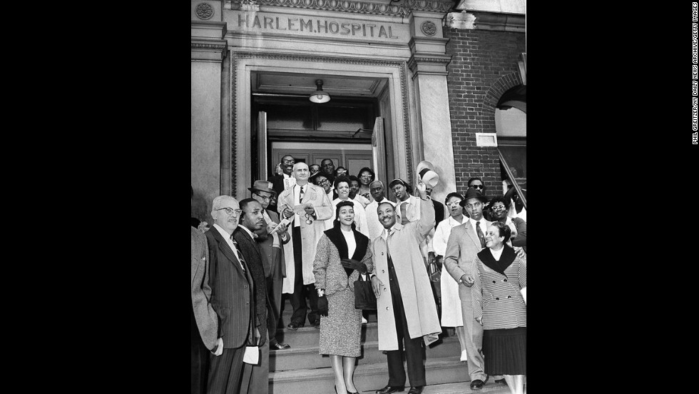 Accompanied by his wife, Coretta Scott, King leaves Harlem Hospital after being stabbed near the heart on September 20, 1958. The near-fatal incident occurred when he was autographing copies of his book at a Harlem bookstore.