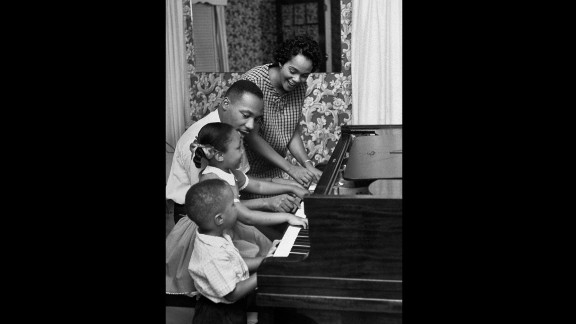 King, his wife and children, Yolanda, 5, and Martin Luther III, 3, play the piano together in their living room in Atlanta in 1960.
