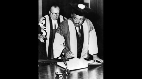 King signs the Degree Roll at Newcastle University after receiving an honorary Doctor of Civil Law degree, in Newcastle, England, on November 14, 1967.