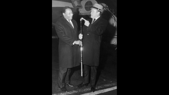 King and comedian Bob Hope, right, talk at John F. Kennedy International airport in New York on November 14, 1967.
