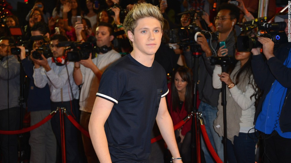 Niall Horan, who has retained his clean-cut image while the rest of the group continue to pack on the ink.