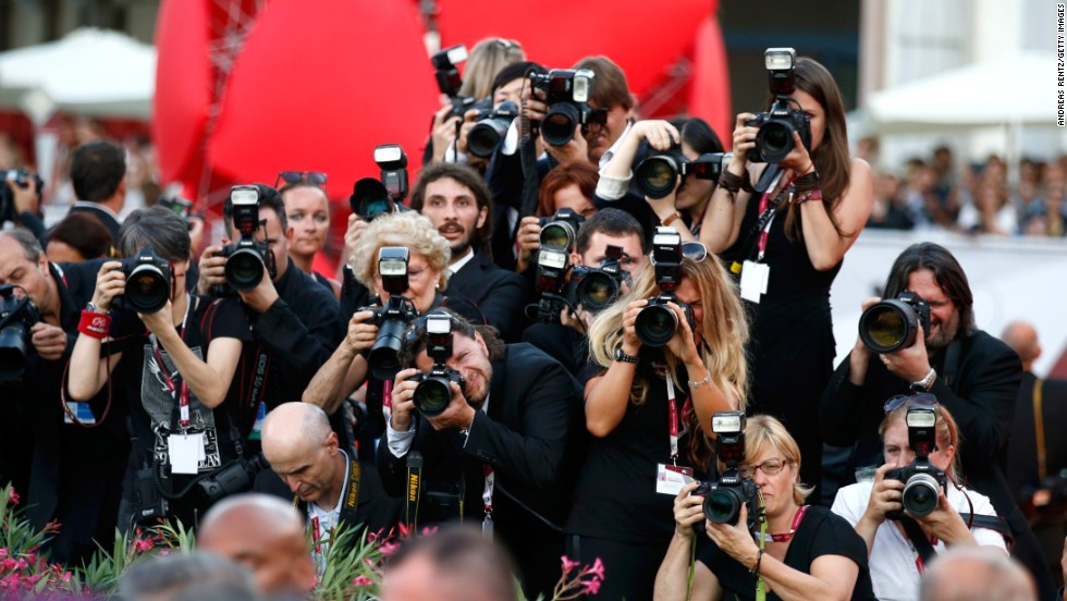 Photographers at the opening ceremony on August 28.