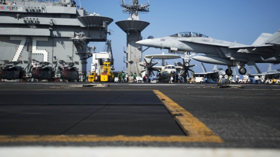 """A picture released by the US Navy shows an F/A-18F Super Hornet assigned to the Swordsmen of Strike Fighter Squadron 32 performing a touch and go on the flight deck of the aircraft carrier USS Harry S. Truman (CVN 75) on August 15, 2013 in the Mediterranean Sea. US forces are """"ready to go"""" if called on to strike the Syrian regime, Defense Secretary Chuck Hagel told the BBC on August 27, 2013, saying evidence pointed to its use of chemical weapons. The Pentagon chief said forces had been deployed as needed and President Barack Obama had reviewed military options presented by commanders. AFP PHOTO/US NAVY Lyle H. Wilkie III"""
