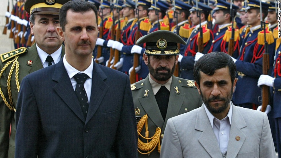 Al-Assad and Iran's Mahmoud Ahmadinejad review the honor guard at Damascus airport on January 19, 2006.