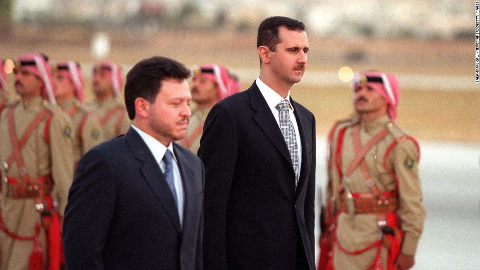 Jordanian King Abdullah ll and al-Assad inspect the honor guard on October 18, 2000, in Amman, Jordan.