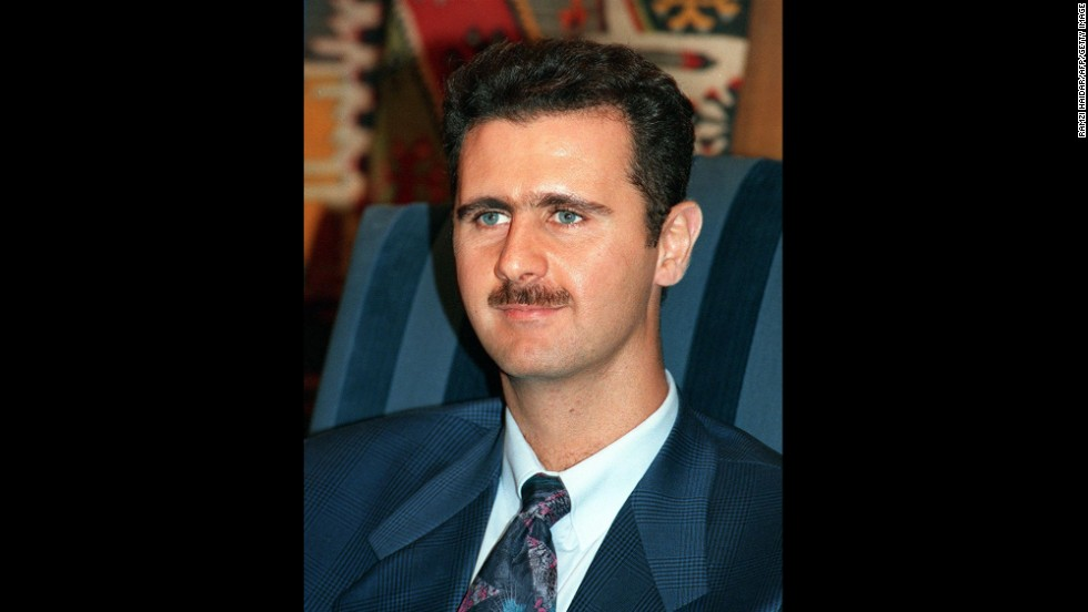 Al-Assad is seen in an 1997 photograph during the time his father, President Hafez Assad, reshuffled the top of the Syrian military. The move was seen as an effort to clear the way for al-Assad to rise to power.