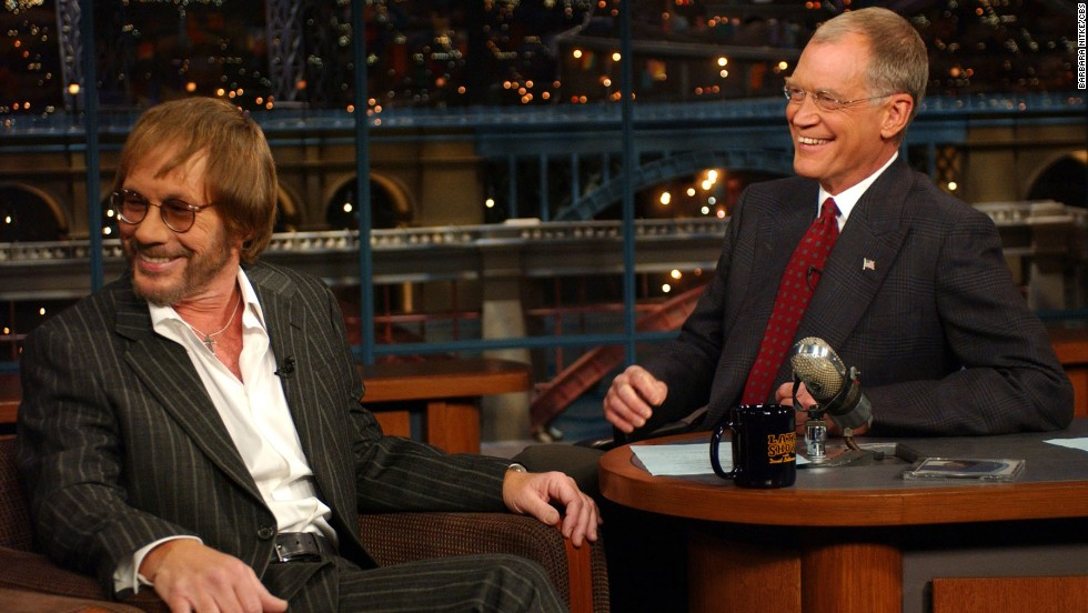 "Born in Chicago, Grammy-winning singer/songwriter Warren Zevon -- seen here with late-night TV host David Letteman -- may be remembered most for his 1978 album, ""Excitable Boy."" Along with its Top 40 single ""Werewolves of London,"" other tracks on the LP offer great examples of Zevon's imagination and humor, such as ""Roland the Headless Thompson Gunner,"" and ""Lawyers, Guns and Money."" Singer Linda Ronstadt had a hit that same year with her cover of Zevon's ""Poor, Poor Pitiful Me."" Zevon died of cancer in 2003 at age 56."