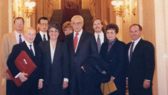 Hans Ephraimson-Abt, front left, and other KAL 007 family members pose with diplomats at the Kremlin in 1992 after gaining access to cockpit data for the first time.