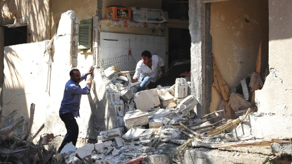 People search for belongings in rubble in Raqqa, Syria, on August 29.
