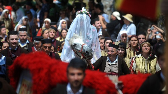 A bride rides to church in the western Macedonian village of Galicnik.