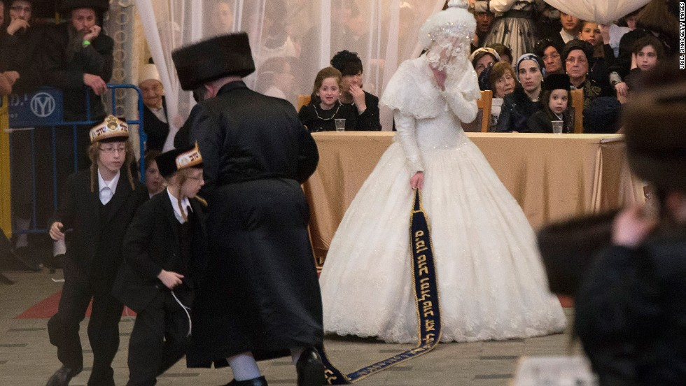 In Jerusalem, Hannah Batya Penet dances with her relative during her wedding to Rabbi Shalom Rokach, the grandson of the Belz rabbi.