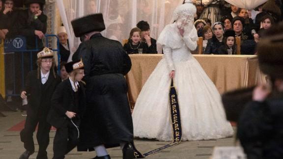 In Jerusalem, Hannah Batya Penet dances with her relative during her wedding to Rabbi Shalom Rokach, the grandson of the Belz rabbi.