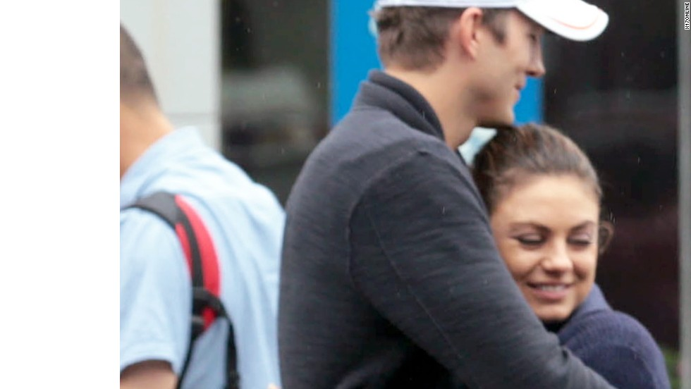 Ashton Kutcher and Mila Kunis embrace while visiting the Great Wall of China on August 29.