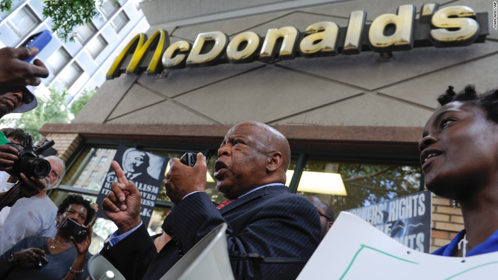 Rep. John Lewis, a Georgia Democrat who was the youngest keynote speaker at the 1963 March on Washington, speaks to demonstrators for higher wages outside a McDonald's in Atlanta.