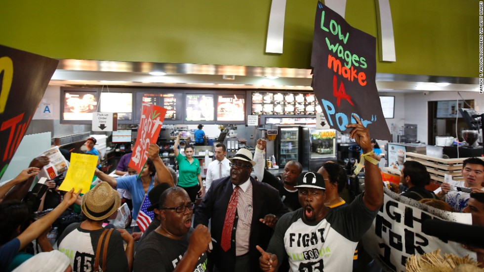 A protest organized by the Service Employees International Union takes place inside a McDonald's in Los Angeles on August 29.