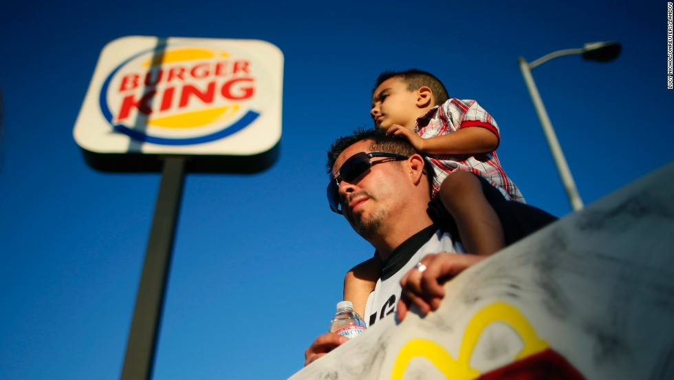 Demonstrators rally outside of a Burger King in Los Angeles on August 29.