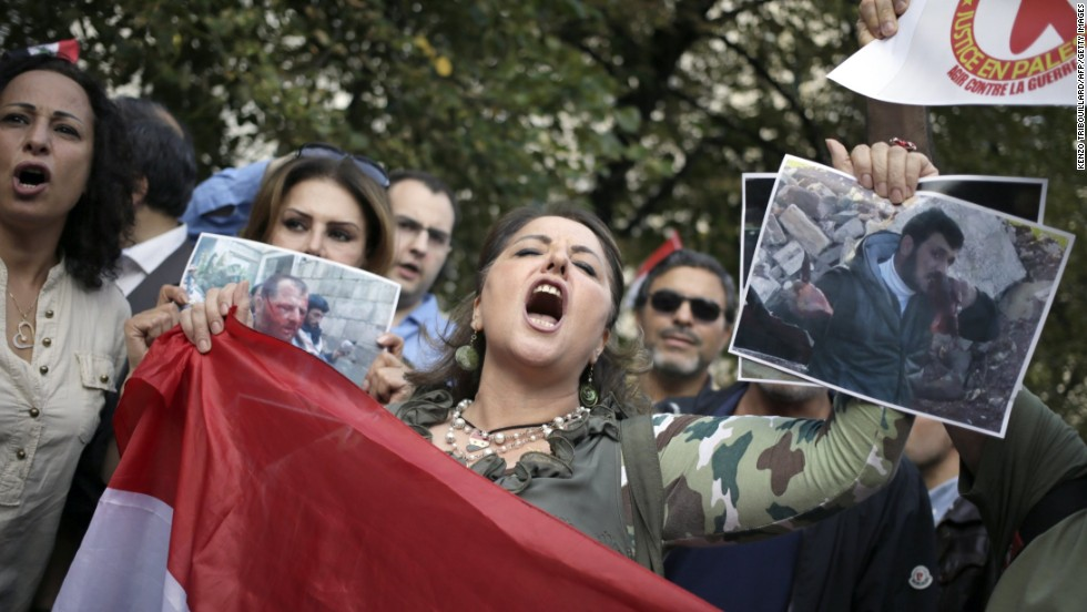 A supporter of the Syrian regime demonstrates August 29 in Paris against possible Western military involvement in Syria.
