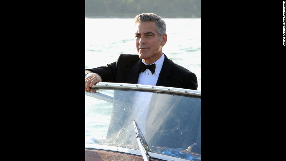 Actor George Clooney arrives by boat on  August 28.