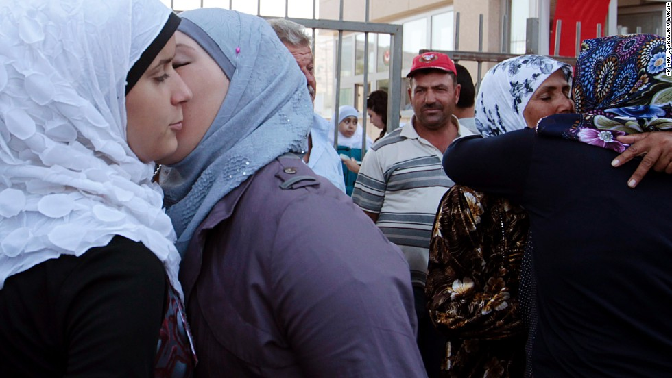 "AUGUST 30 - CILVEGOZU, TURKEY: <a href=""http://cnn.com/2013/08/28/world/meast/syria-how-did-we-get-here/index.html"">Syrian refugees</a> greet each other at the Turkish Cilvegozu gate border with Syria. The crisis in Syria has escalated this week, with United Nations experts investigating the alleged use of <a href=""http://cnn.com/2013/08/28/world/meast/syria-how-did-we-get-here/index.html?hpt=hp_t2"">chemical weapons</a>. The U.S. and allies are preparing for the <a href=""http://cnn.com/2013/08/30/world/europe/syria-civil-war/index.html?hpt=hp_t1"">possibility of a punitive strike</a> against President Bashar al-Assad's regime."