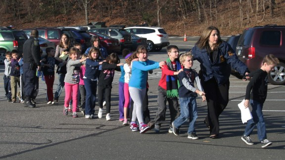 """In the immediate aftermath of the 2012 shooting at Sandy Hook Elementary School, local journalist Shannon Hicks witnessed police escorting children out of the school in Newtown, Connecticut. """"I knew that, coming out of the building -- as terrified as they were -- those children were safe,"""" Hicks later told Time magazine. """"I just felt that it was an important moment."""" The photograph made it onto the front pages of newspapers, magazines and websites around the world."""