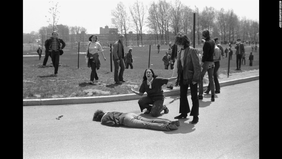 Mary Ann Vecchio screams as she kneels over Jeffrey Miller's body during an anti-war demonstration in 1970 at Kent State University. Student photographer John Filo captured the Pulitzer Prize-winning image after Ohio National Guardsmen fired into the crowd of protesters, killing four students and wounding nine others. A widely published version of the image was manipulated by an anonymous editor to remove the fence post above Vecchio's head, sparking a major controversy.