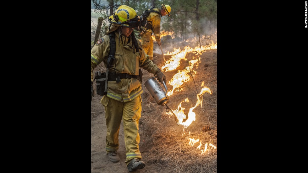 Firefighters from Sacramento Metro burn around an old cabin in Ackerson Meadow near Yosemite National Park on August 28.