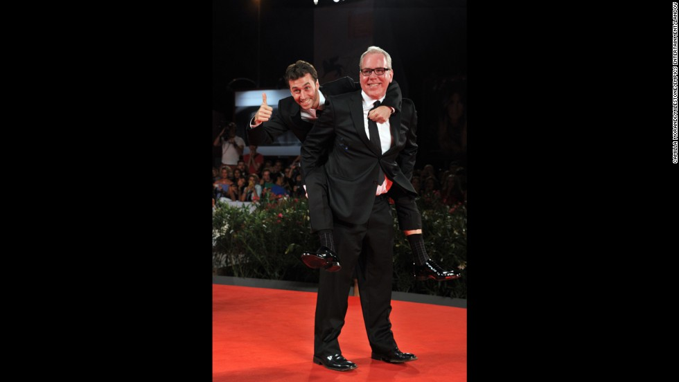 "Actor James Deen gets a piggy-back ride from writer Bret Easton Ellis at ""The Canyons"" premiere on August 30."