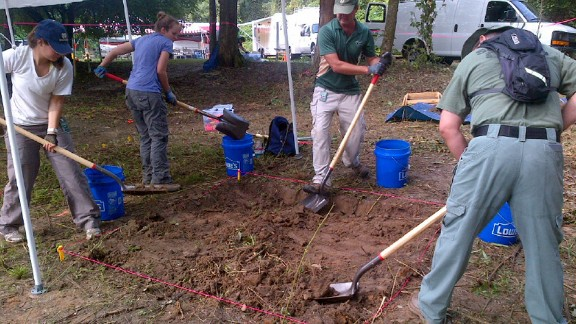 Anthropologists dig on the grounds of the former school in Marianna, Florida.