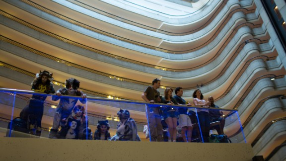 Onlookers watch the crowds that fill the lobby of the Marriott Marquis late Friday night.