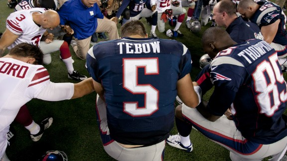 Tebow prays with his New England Patriots teammates and members of the New York Giants after a preseason game in Foxborough, Massachusetts, in 2013. Tebow has always been outspoken about his Christian faith.