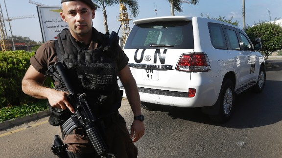 A Lebanese special forces policeman escorts the vehicles of U.N. experts on the arrival at the private jet terminal, at Beirut international airport, Lebanon, Saturday, Aug. 31, 2013. The U.N. experts investigating last week