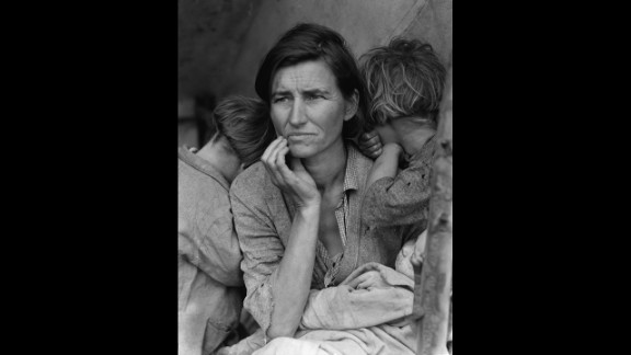 """Dorothea Lange's photograph of a struggling mother with her children in 1936 became an icon of the Great Depression. Lange was traveling through California, taking photographs of migrant farm workers for the Resettlement Administration, when she came across Florence Owens Thompson. """"I saw and approached the hungry and desperate mother, as if drawn by a magnet,"""" Lange recalled in 1960. The image was retouched to remove the woman's thumb from the lower right corner."""